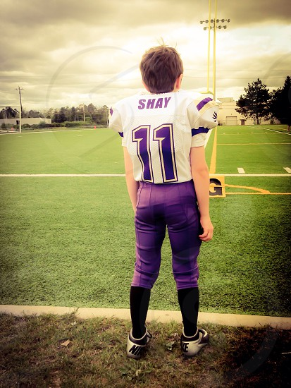 American football team sports jersey field player athlete anticipation concentration  photo