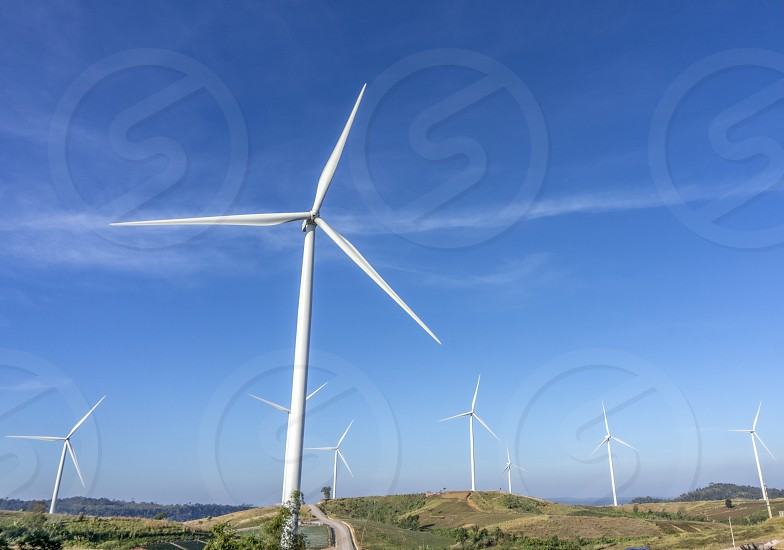 Wind turbines. Wind power generators. Alternative energy reduce global warming. Reduce insufficient energy problems. photo