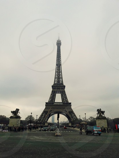 Famous Paris landmark Eiffel Tower view from the street  photo