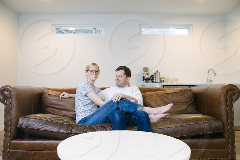 Young married couple hanging out at home having fun. photo