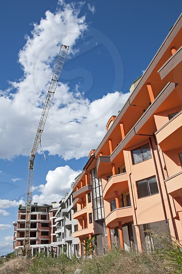 Construction industry and cran. New colored building photo