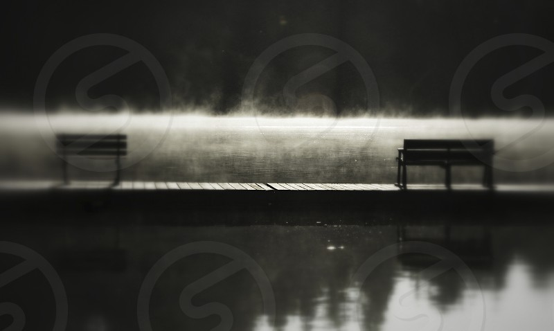 Steam rising from the lake  photo
