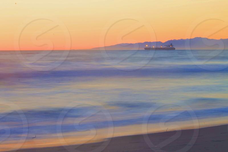 Boat in Pacific Ocean photo