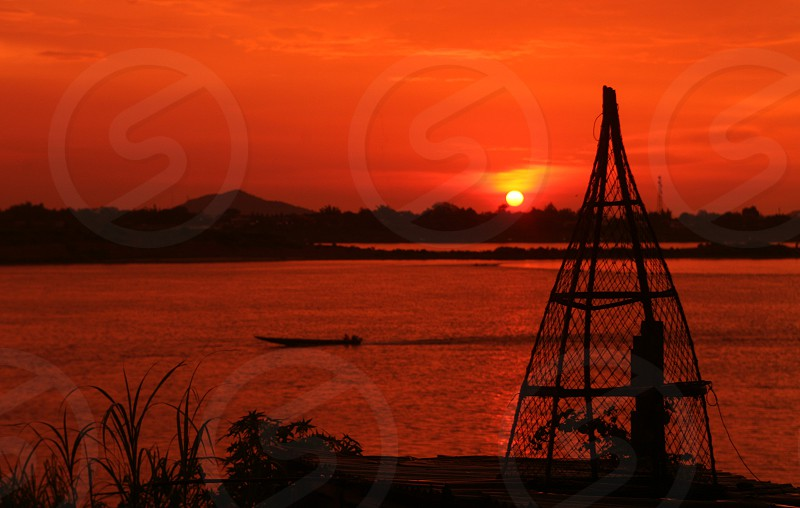 a sunset at the Mekong river in the town of Savannakhet in central Lao in the region of Khammuan in Lao in Souteastasia. photo