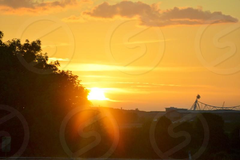 sunrise over trees photo