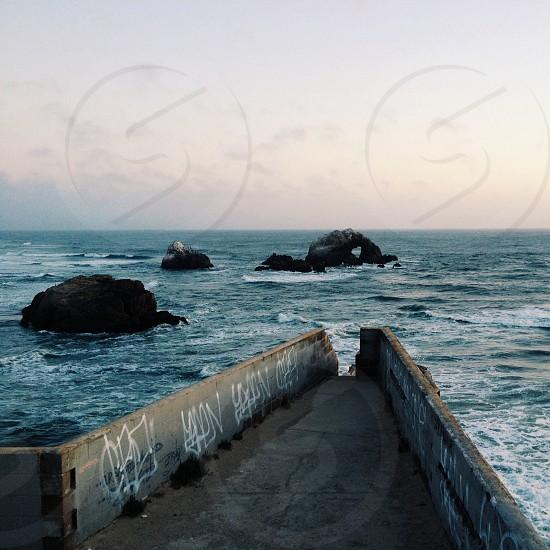 rock on ocean photo