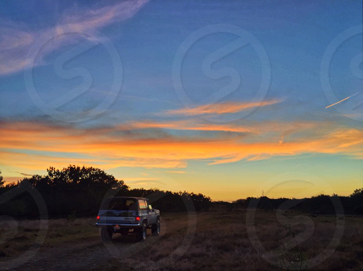 Vintage truck tail lights pasture field rural dirt road road trip explore vintage car off road sunset country country road back road adventure open road  photo