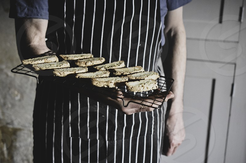 Man with tray of freshly baked biscuits photo