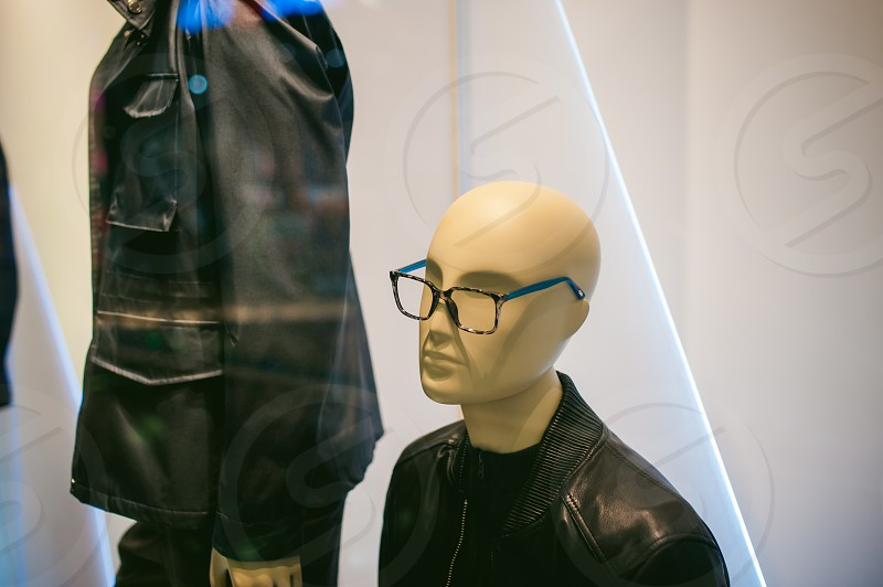 dummy on a shop window. Faceless man's glasses photo