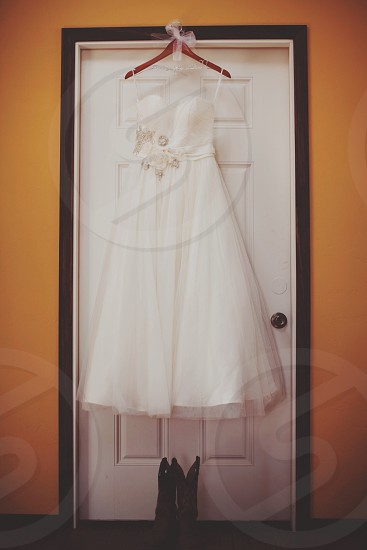 women's white gown and boots  photo