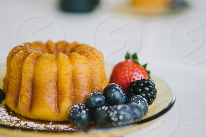 view of fruit in brown ceramic plate photo