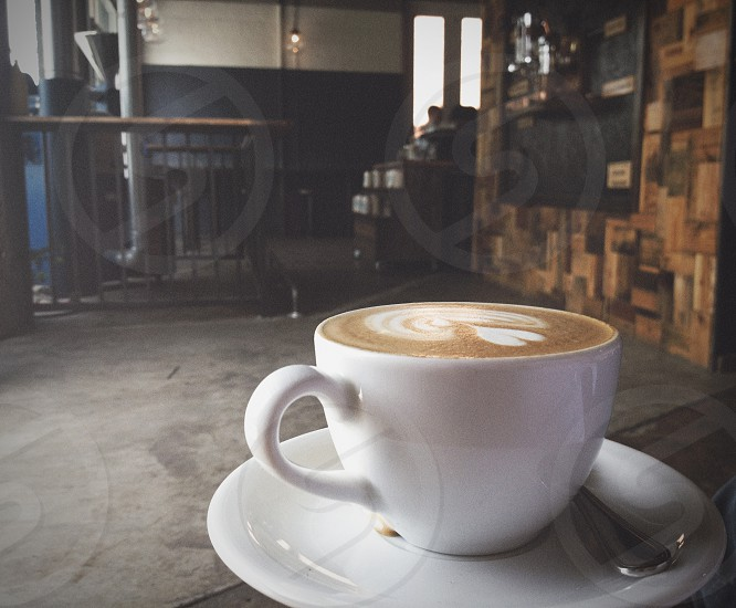 Latte and a coffee shop.  photo