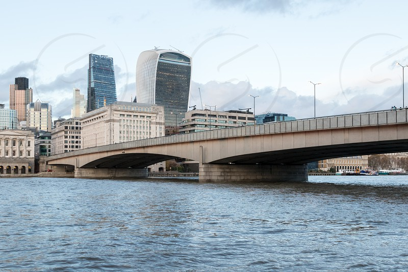 A photo of London Bridge - with GPS coordinates featuring in the background two recent skysrapers called : 20 Fenchurch Street (walkie talkie) and 122 Leadenhall (cheesegrater). photo