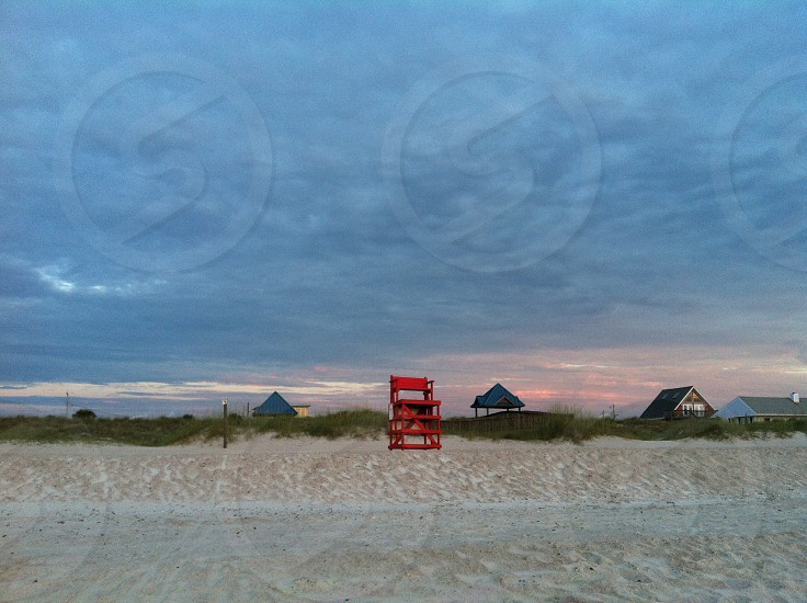 red wooden life guard high chair photo
