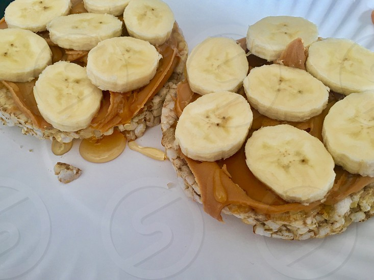 Rice cakes peanut butter honey ripe bananas healthy and delicious  photo