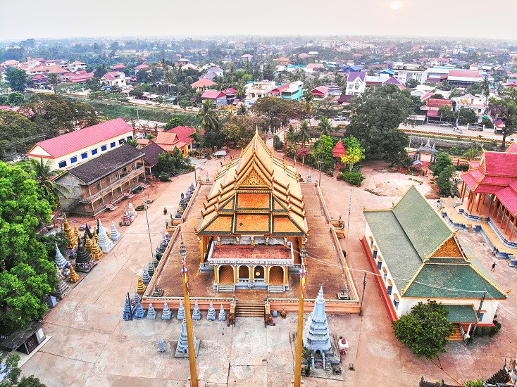 Aerial drone view topdown eagle eye of a traditionnal temple pagoda cemetery in siem reap cambodia asia photo
