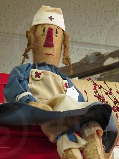 Cloth doll dressed in a nurse's uniform photo