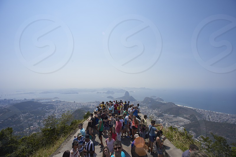 Crowds enjoying the view of Rio de Janeiro from the platform on top of the mountain at the Christ the Redeemer statue photo