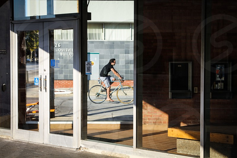 Man on bike.  photo