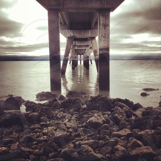 under a wooden bridge photo