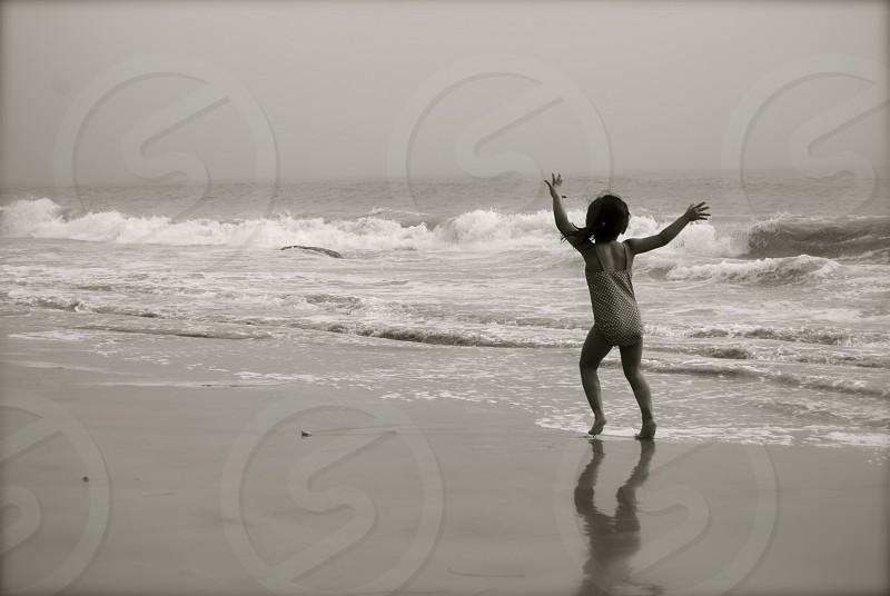child playing on beach photo