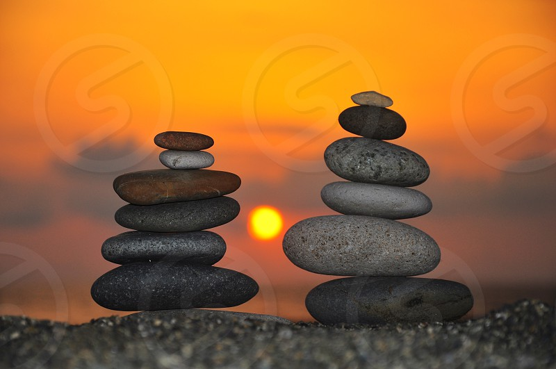 stacked stones sunset view photo