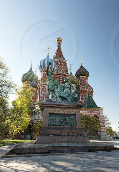 Minin and Pozharsky monument with St Basil cathedral in the background - Moscow Russia photo