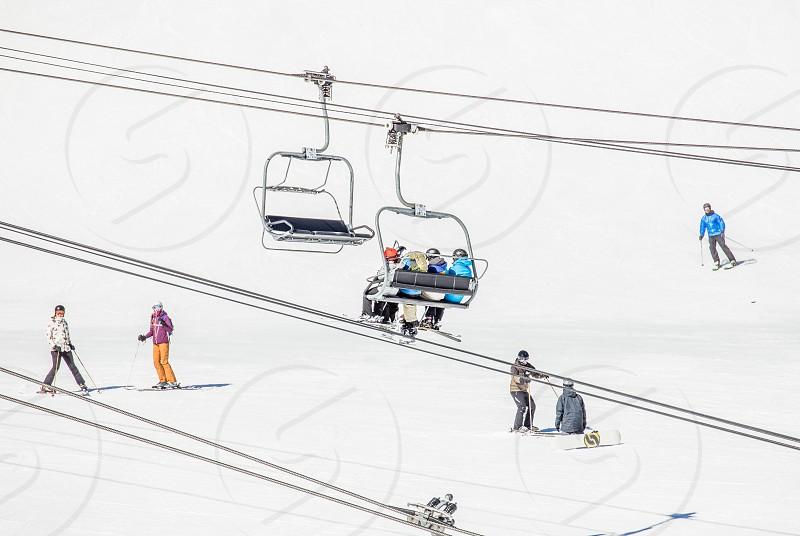 Snowboarders and ski lift photo