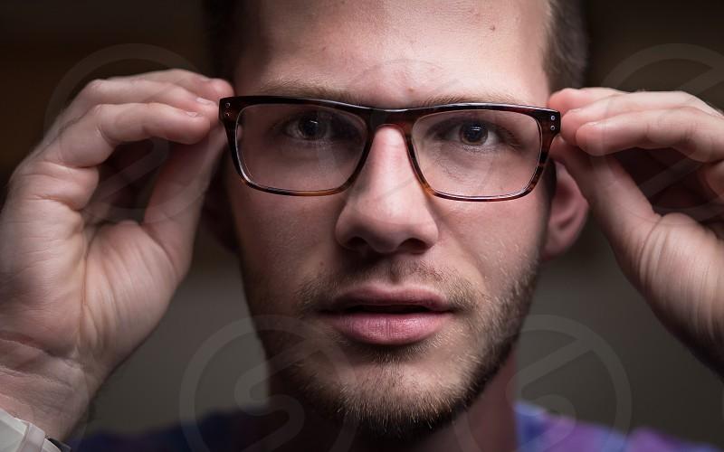 man trying on eyeglasses photo
