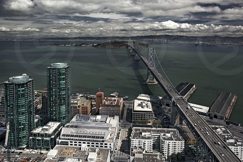 Aerial view of the San Francisco Bay Bridge and The Infinity Towers at left 2014. In the distance is Treasure Island. photo