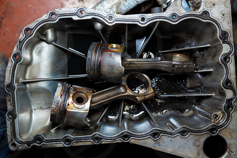 Open car engine with cylinders piston and rod of used car repair photo