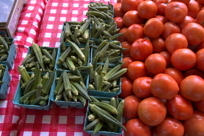 Okra and tomatoes at farmers market photo