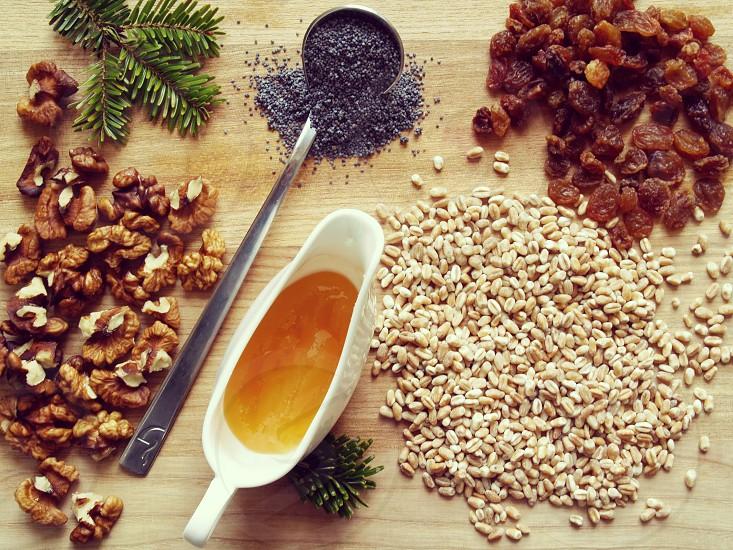 ingredients prepering traditional dish nuts honey raisins grain photo