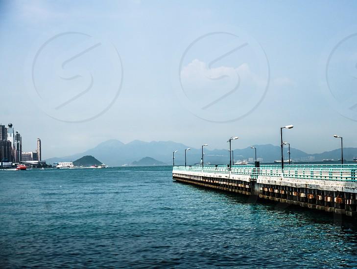An long dockyard with no ships around photo