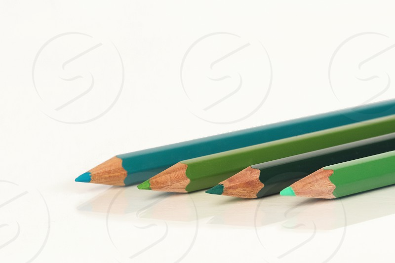 Colored pencils on a white background. photo