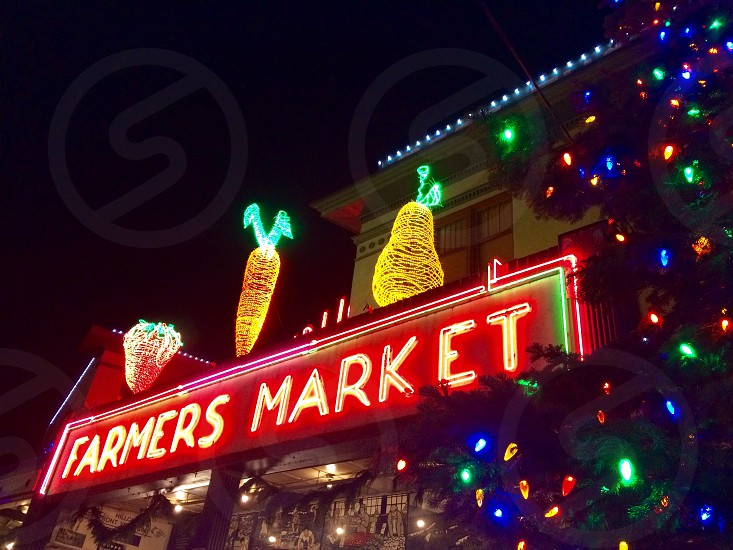 low view photo of farmers market neon signage during nightime photo