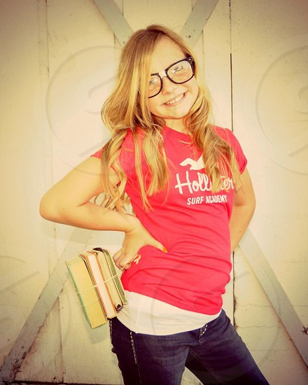 woman wearing black framed eyeglasses and pink hollister shirt photo