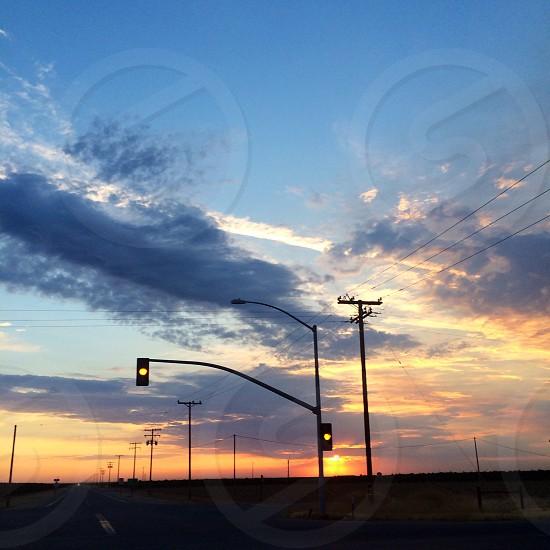 traffic light beside utility post during sunlight photo
