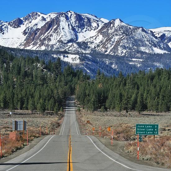 road across alp mountain photo