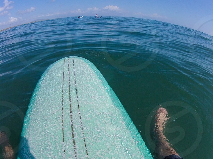 surfing surfboard wide angle pov clear green water blue sky surfers surfer wax wide-angle photo