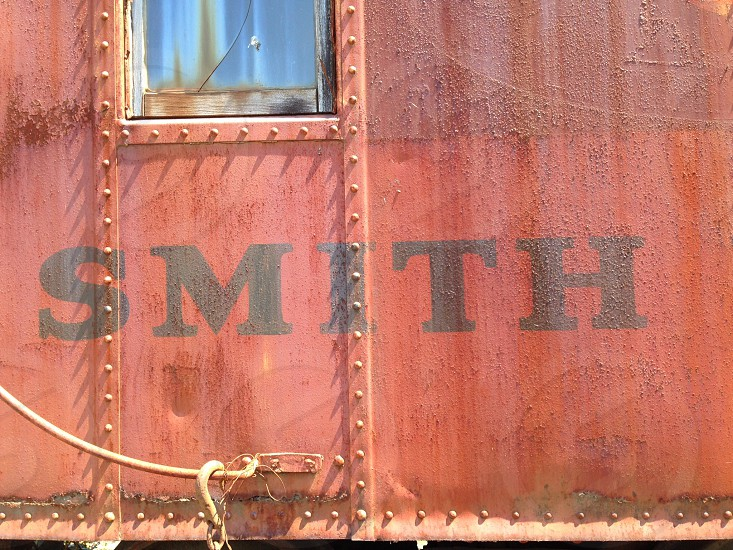 Rusty red caboose train car smith rivet rust logging forest equipment travel photo