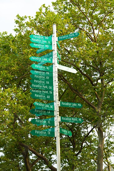 Paradise sign signal post in New York Battery Park USA photo