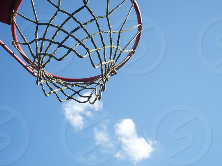 red metal framed basketball net photo