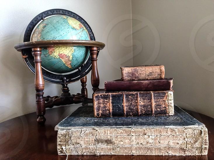 brown desk glove beside books photo