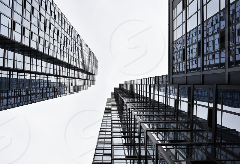 Modern building glass and metal construction against the sky photo