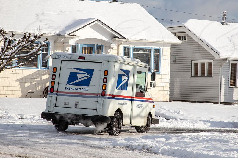 Everett WA. / USA - 02/09/2019: US Postal Service Jeep Delivering Mail During Unusual Winter Snow Storm photo