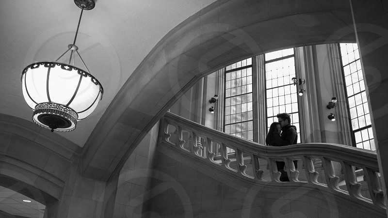 couple kissing on stairs photograph photo