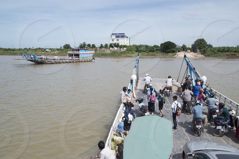 a ferry for cars and Motorbike at the Mekong River in the city of Phnom Penh of Cambodia.  Cambodia Phnom Penh November 2017 photo