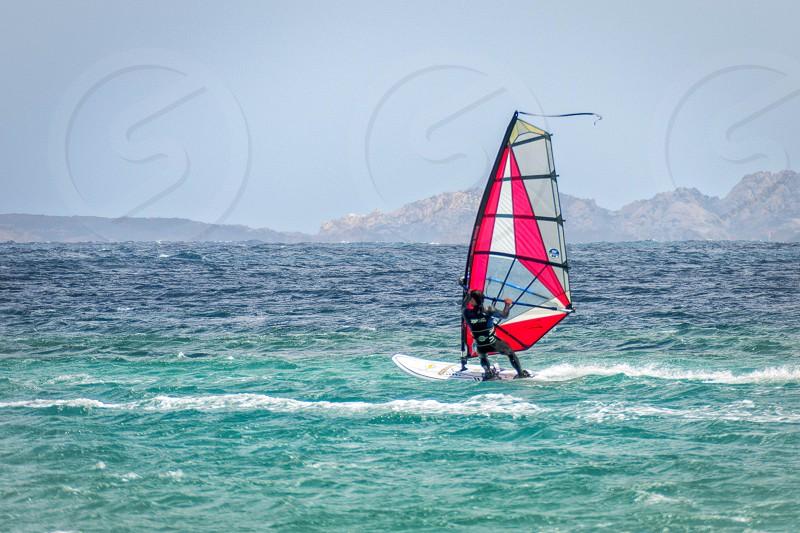 PORTO POLLO SARDINIA/ITALY - MAY 21 : Windsurfing at Porto Pollo in Sardinia on May 21 2015. Unidentified man photo