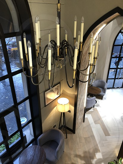 Beautiful corner of the apartment. Beautiful chandelier. The view from the top. photo
